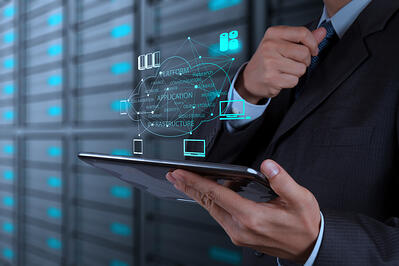 a man holding a tablet with cloud migration's icons